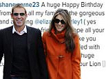 Liz Hurley and Shane Warne pictured going out for lunch in Chelsea, UK. Liz wore a bright orange jacket. \n\nPictured: Liz Hurley and Shane Warne\n\nRef: SPL337586  231111  \nPicture by: Splash News\n\nSplash News and Pictures\nLos Angeles:\t310-821-2666\nNew York:\t212-619-2666\nLondon:\t870-934-2666\nphotodesk@splashnews.com\n