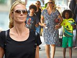 New York, NY - Heidi Klum and her brood walk to Nobu in Tribeca for an early dinner in New York. The model was dressed casual in distressed jeans, flip flops with messy hair and shades as she and her mother took the kids out.\n \nAKM-GSI   June  9, 2015\nTo License These Photos, Please Contact :\nSteve Ginsburg\n(310) 505-8447\n(323) 423-9397\nsteve@akmgsi.com\nsales@akmgsi.com\nor\nMaria Buda\n(917) 242-1505\nmbuda@akmgsi.com\nginsburgspalyinc@gmail.com
