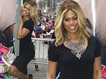 """Laverne Cox poses at the """"Orange is the New Black"""" Times Square Take Over on Wednesday, June 10, 2015, in New York. (Photo by Charles Sykes/Invision/AP)"""