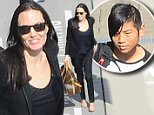 10 June 2015.\nAngelina Jolie and Maddox seen arriving at London Heathrow Airport this afternoon. \nCredit: Ben Eade/GoffPhotos.com   Ref: KGC-102\n