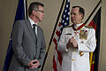 Defense.gov News Photo 110609-N-TT977-358 - Chairman of the Joint Chiefs of Staff Adm. Mike Mullen thanks German Minister of Defense Thomas de Maiziäre after receiving the German Order of.jpg