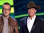 NASHVILLE, TN - JUNE 10:  Tom Arnold and Arnold Schwarzenegger speak onstage during the 2015 CMT Music awards at the Bridgestone Arena on June 10, 2015 in Nashville, Tennessee.  (Photo by John Shearer/WireImage)