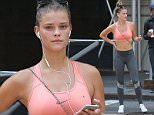Victoria's Secret swimsuit cover model Nina Agdal has a sweaty jogging workout in the busy streets of New York City in the hot summer. The model was spotted looking at her iphone during a break as she looked into the camera as a man behind her checked out her backside. \n\nPictured: Nina Agdal\nRef: SPL1048764  110615  \nPicture by: Turgeon/Prahl Splash News\n\nSplash News and Pictures\nLos Angeles: 310-821-2666\nNew York: 212-619-2666\nLondon: 870-934-2666\nphotodesk@splashnews.com\n