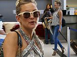 EXCLUSIVE. Coleman-Rayner. Los Angeles, CA, USA.\nJune 11, 2015 \nKate Hudson is spotted checking-in to an international flight at Tom Bradley airport. The stylish actress went incognito, wearing a hat, sunglasses, and black-and-white patterned halter top. She was joined by her 11-year-old son, Ryder, and a friend. \nCREDIT LINE MUST READ: Coleman-Rayner\nTel US (001) 310-474-4343- office\nTel US (001) 323-545-7584 - Mobile\nwww.coleman-rayner.com