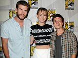 """SAN DIEGO, CA - JULY 20:  (L-R) Actor Liam Hemsworth, actress Jennifer Lawrence and actor Josh Hutcherson appear at the Lionsgate preview featuring """"I, Frankenstein"""" and """"The Hunger Games: Catching Fire"""" during Comic-Con International 2013 at San Diego Convention Center on July 20, 2013 in San Diego, California.  (Photo by Albert L. Ortega/Getty Images)"""