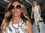 Los Angeles, CA - LeAnn Rimes is a happy traveler at LAX as she arrives for a flight out of Los Angeles in a black and white patterned dress and leather booties with a smile. \nAKM-GSI   June  11, 2015\nTo License These Photos, Please Contact :\nSteve Ginsburg\n(310) 505-8447\n(323) 423-9397\nsteve@akmgsi.com\nsales@akmgsi.com\nor\nMaria Buda\n(917) 242-1505\nmbuda@akmgsi.com\nginsburgspalyinc@gmail.com