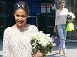 Picture Shows: Lisa Snowdon  June 12, 2015: June 12, 2015\n \n Radio presenter Lisa Snowdon was all smiles as she left Capital Radio studios with a huge bouquet of flowers in London, England.\n \n Lisa's flowers were conveniently co-ordinated with her sheer white lace top which she paired with a distressed blue jeans and a pair of strappy heels.\n \n Non Exclusive\n WORLDWIDE RIGHTS\n \n Pictures by : FameFlynet UK © 2015\n Tel : +44 (0)20 3551 5049\n Email : info@fameflynet.uk.com