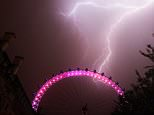 Lightning strikes behind The London Eye in central London which is coloured red, white and blue to mark the birth of a baby boy, at 4.24pm yesterday to the Duke and Duchess of Cambridge at St Mary's Hospital. PRESS ASSOCIATION Photo. Picture date: Tuesday July 23, 2013. Prince William and Kate spent the night at hospital bonding with their new son who was delivered at 4.24pm on Monday weighing 8lb 6oz. See PA story WEATHER Storms. Photo credit should read: Lewis Whyld/PA Wire