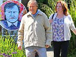 Coronation Streets Roy Cropper (played by David Neilson) drives the new woman in his life Cathy Matthews (played y Melanie Hill) back to her house and Cathy is carrying a portrait of Roy as she gets out of the Morris Minor car that Roy drives.