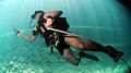 US Navy 110609-N-XD935-152 Navy Diver 3rd Class Bryan Myers, assigned to Mobile Diving and Salvage Unit (MDSU) 2, maneuvers under a Barbadian coast.jpg