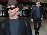 """Los Angeles, CA - Actor Hugh Jackman looks excited to arrive back in Los Angeles after a long flight.  The """"Wolverine"""" actor works hard as a humanitarian and gives  back to the community by becoming an ambassador for World Vision Australia. ..  ..AKM-GSI       June 12, 2015..To License These Photos, Please Contact :..Steve Ginsburg..(310) 505-8447..(323) 423-9397..steve@akmgsi.com..sales@akmgsi.com..or..Maria Buda..(917) 242-1505..mbuda@akmgsi.com..ginsburgspalyinc@gmail.com"""