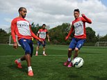 LONDON, ENGLAND - MAY 16: (L-R) Theo Walcott and Mesut Ozil of Arsenal during a training session at London Colney on May 16, 2015 in St Albans, England. (Photo by Stuart MacFarlane/Arsenal FC via Getty Images)