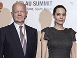 Former British first Secretary of State William Hague, United States actress and UNHCR representative Angelina Jolie (C) and African Union Commission chairperson Nkosasana Dlamini-Zuma pose for a picture ahead of a panel on Conflict related gender violence on June 12, 2015 during a session of the African Union Summit in Johannesburg, South Africa.  AFP PHOTO / GIANLUIGI GUERCIAGIANLUIGI GUERCIA/AFP/Getty Images