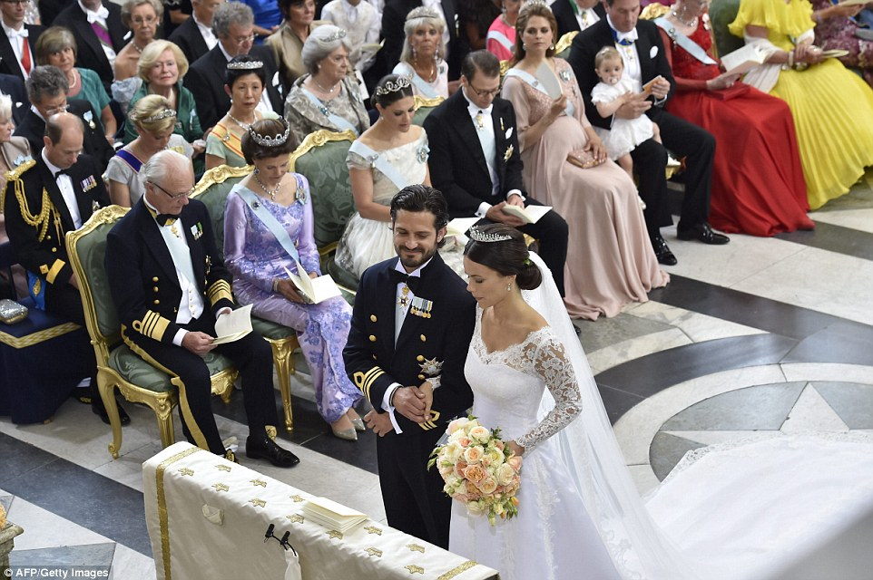 Sofia Hellqvist and Sweden's Prince Carl Philip stand at the alter during their wedding ceremony at the Royal Chapel in Stockholm Palace