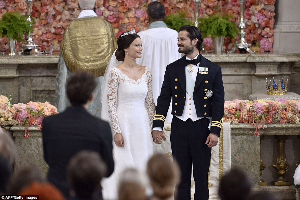 The couple gaze into each other's eyes during their extravagant wedding ceremony in Stockholm Palace this afternoon