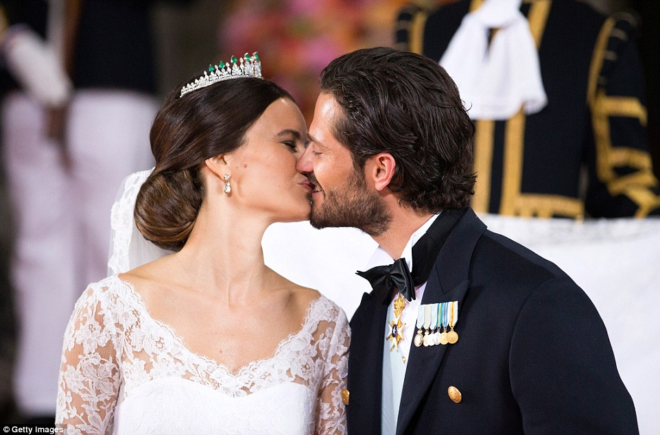 Prince Carl Philip of Sweden, with his slicked back hair, kisses his new wife Princess Sofia of Sweden