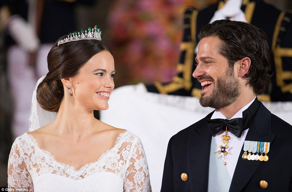 The newly married couple grin after exchanging their wedding rings and saying their vows at the lavish ceremony in the Swedish capital