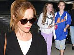 Los Angeles, CA - Leslie Mann and her daughters Maude Apatow and Iris Apatow make their way through Los Angeles International Airport.\n \nAKM-GSI June 12, 2015\n \n To License These Photos, Please Contact :\n \n Steve Ginsburg\n (310) 505-8447\n (323) 423-9397\n steve@akmgsi.com\n sales@akmgsi.com\n \n or\n \n Maria Buda\n (917) 242-1505\n mbuda@akmgsi.com\n ginsburgspalyinc@gmail.com