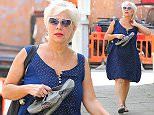 Denise Welch looks summery as she pops into Alderley Edge, Cheshire on Friday afternoon carrying her going out shoes and wearing her sandals....... 12.6.15.