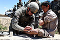 Defense.gov News Photo 100609-A-6285M-144 - U.S. Army Sgt. John Russell left assigned to the 173rd Airborne Brigade Combat Team gives a small child medical care in the Logar province of.jpg