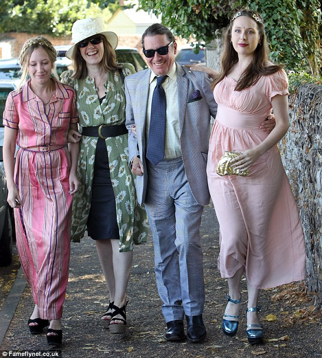 Ready for a good time: Jools Holland was among some of the guests who attended the ceremony at the St Mary Magdalene and St Lawrence Church in the village of Davington
