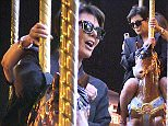 EXCLUSIVE ALL ROUNDER ***SPECIAL FEES APPLY*** Kris Jenner goes on a merry-go-round with designer Olivier Rousteing at the Eiffel Tower in Paris, 11 June 2015.\n12 June 2015.\nPlease byline: Vantagenews.co.uk