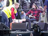 "A screen shows singer of US band ""Foo Fighters"" Dave Grohl in the background of the empty stage during the band's concert att Nya Ullevi in Gothenburg, Sweden, on June 12, 2015. Grohl broke his leg while performing on stage in Gothenburg."