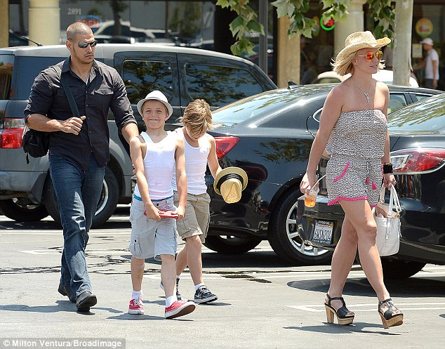 Just the three of us - and the bodyguard: The family were joined by Britney's omnipresent security guard