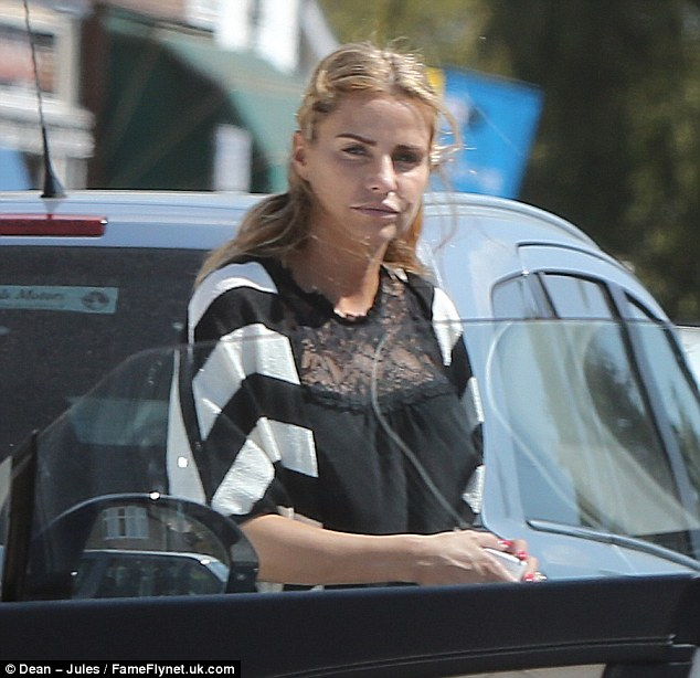 Mindful: Walking along the city's seafront, she seemed preoccupied as she climbed into her car following a visit to a local nail salon, where she enjoyed a manicure