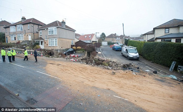 The scene of the accident in which an out-of-control tipper truck killed four people, including a young girl in Bath, Somserset. Sand which  spilled from the truck remained next to the smashed wall this morning