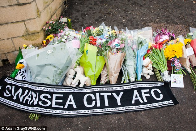 The family - who said they were 'devastated' - also laid a Swansea City  scarf in honour of Mr Allen