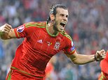 Football - Wales v Belgium - UEFA Euro 2016 Qualifying Group B - Cardiff City Stadium, Cardiff, Wales - 12/6/15  Gareth Bale celebrates after scoring the first goal for Wales  Reuters / Rebecca Naden  Livepic