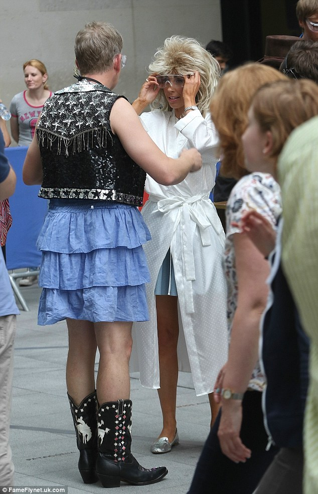 Bizarre: Kielty appeared happy to show off his own ensemble - a denim skirt and embellished leather waistcoat