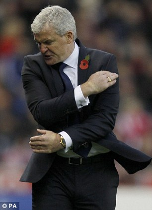 Under pressure: Mark Hughes is fighting to save QPR's season... and his own managerial career