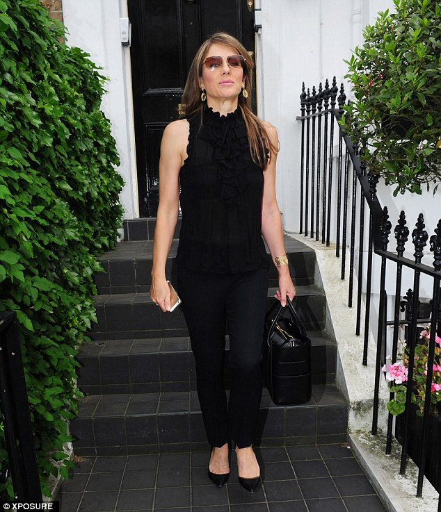 Looking good: Liz Hurley, who celebrated her landmark 50th birthday on Wednesday, was seen leaving her London home for a lunch date on Saturday afternoon