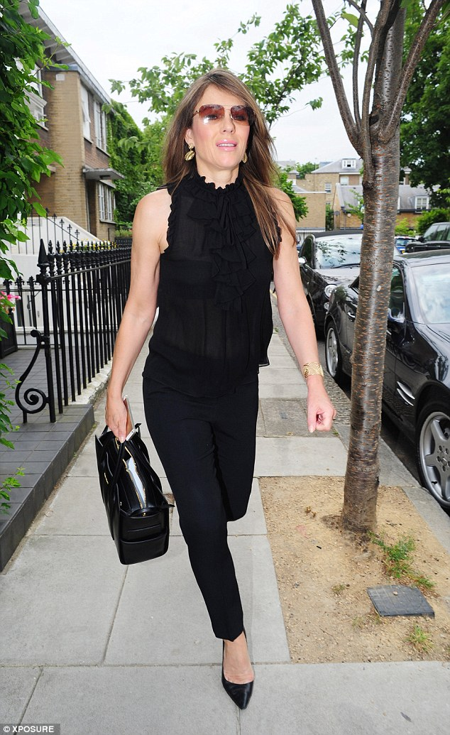 Style: Wearing a semi-sheer black top and cropped trousers, she accessorised her outfit with a pair of designer sunglasses and some flat, slip-on shoes
