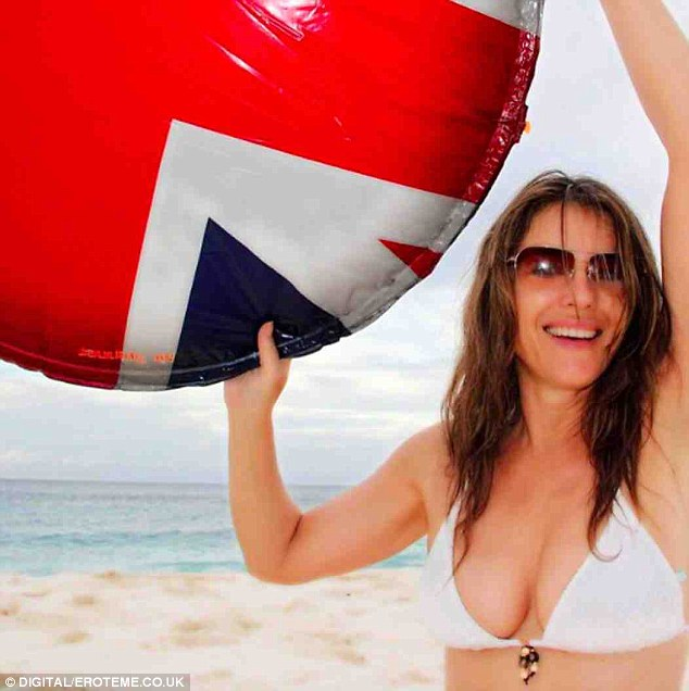 Good times: Liz flaunts her fabulous shape in a very patriotic beach selfie
