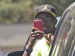 EXCLUSIVE: Mo Farah turns the camera on photographers in Portland, Oregon. The British athlete was spotted for the first time since doping allegations were made against his coach Alberto Salazar. Mo, who leaned out of his car window and snapped pictures on his iPhone on June 9, 2015, flew to Portland after pulling out of a Diamond League event in Birmingham, England. A BBC Panorama documentary has accused Salazar of being involved in doping with US athlete Galen Rupp. They have both denied the allegations. Pics taken June 9th.  Pictured:  Mo Farah Ref: SPL1042523  120615   EXCLUSIVE Picture by: Splash News  Splash News and Pictures Los Angeles: 310-821-2666 New York: 212-619-2666 London: 870-934-2666 photodesk@splashnews.com
