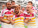 Shaun Maloney of Scotland (6) celebrates his goal with team-mates, 1-1