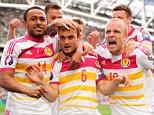 Shaun Maloney of Scotland (6) celebrates his goal with team-mates, 1-1