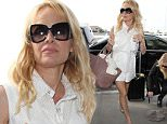 Picture Shows: Pamela Anderson  June 12, 2015\n \n Actress Pamela Anderson departing on a flight at LAX airport in Los Angeles, California. Pamela was kind enough to stop and sign a couple of autographs before heading inside.\n \n Non-Exclusive\n UK RIGHTS ONLY\n \n Pictures by : FameFlynet UK © 2015\n Tel : +44 (0)20 3551 5049\n Email : info@fameflynet.uk.com