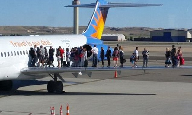 Incredible photo shows Allegiant Air passengers escaping onto plane's WING after fumes