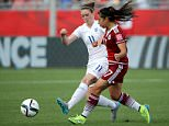 Jun 13, 2015; Moncton, New Brunswick, CAN; England midfielder Jade Moore (11) and Mexico midfielder Veronica Perez (17) battle for the ball during the first half in a Group F soccer match in the 2015 FIFA women's World Cup at Moncton Stadium. Mandatory Credit: Matt Kryger-USA TODAY Sports