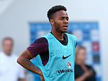 Raheem Sterling and Wayne Rooney of England look tired during training