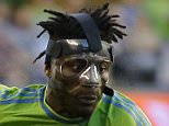 Seattle Sounders' Obafemi Martins wears a protective mask during an MLS soccer match against FC Dallas, Saturday, June 13, 2015, in Seattle. (AP Photo/Ted S. Warren)