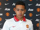 MANCHESTER, ENGLAND - JUNE 12: (EXCLUSIVE COVERAGE) Manchester United's new signing Memphis Depay poses with his new manager Louis Van Gaal following the completion of his transfer at the Aon Training Complex on June 12, 2015 in Manchester, England. (Photo by John Peters/Man Utd via Getty Images)