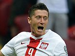 Robert Lewandowski of Poland reacts after scoring a goal during the Euro 2016 Group D qualifying football match Poland vs Georgia in Warsaw, Poland on June 13, 2015.  AFP PHOTO / JANEK SKARZYNSKIJANEK SKARZYNSKI/AFP/Getty Images