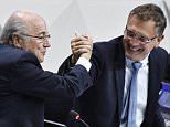 (FILES): This May 29, 2015 file photo shows FIFA President Sepp Blatter (L) shaking hands with FIFA general secretary Jerome Valcke (R) during the 65th FIFA Congress in Zurich, Switzerland. According to June 1, 2015 media reports, federal authorities believe Valcke made some USD10 million in bank transactions, acticvities that are major parts of the ongoing FIFA bribery scandal.    AFP PHOTO / MICHAEL BUHOLZER / FilesMICHAEL BUHOLZER/AFP/Getty Images