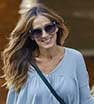 Stunning: Sarah Jessica Parker goes casual in and a T-shirt and jeans for walk with daughters