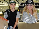 ***MINIMUM FEE £250 PER IMAGE***\\n\\nEXCLUSIVE: Danniella Westbrook and boyfriend Tom Richards arrive at Heathrow Airport from New York .\\n\\nPictured: Tom Richards and Danniella Westbrook\\nRef: SPL868673  191014   EXCLUSIVE\\nPicture by: Splash News\\n\\nSplash News and Pictures\\nLos Angeles:\\t310-821-2666\\nNew York:\\t212-619-2666\\nLondon:\\t870-934-2666\\nphotodesk@splashnews.com\\n